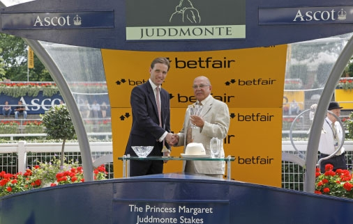 Tony Nerses receives the trophy on behalf of Saleh and Imad after Princes Noor's victory in the Princess Margaret Stakes