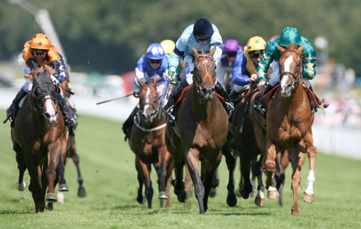 Tariq (right) comes to tackle the leader in the  Jersey Stakes at Royal Ascot